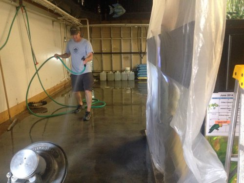 Owner Tim cleaning the floors prior to installing our new tanks