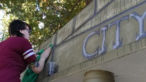 Erin working on the City Hall sign